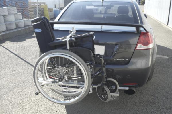 Towbar wheelchair attached